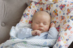 Sleeping baby boy. A sleeping baby boy wrapped in a blanket Stock Photos