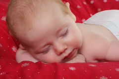 Sleeping baby boy stock image