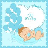 Sleeping baby boy in a blue frame Stock Images