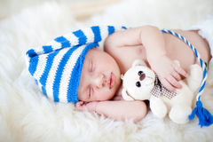 Sleeping baby boy with plush toy Stock Images