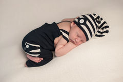 Sleeping Baby Boy in Romper & Hat Stock Images