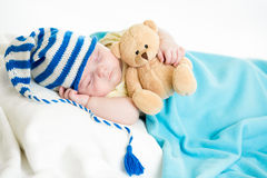 Sleeping baby boy with toy Royalty Free Stock Image