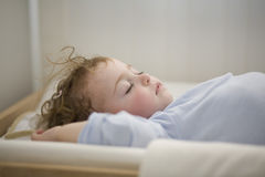 Sleeping baby on the changer Stock Photos