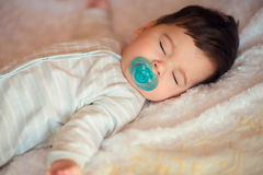 Sleeping baby covered with knitted blanket Royalty Free Stock Images