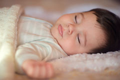 Sleeping baby covered with knitted blanket Royalty Free Stock Photography