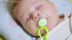 Sleeping baby. In crib sleeping baby with pacifier stock footage
