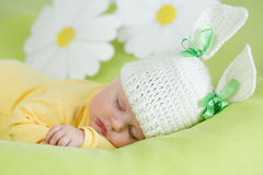 Sleeping baby in funny rabbit hat Stock Photos