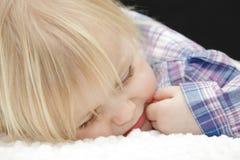 Sleeping baby girl. Adorable blond baby girl sleeping Royalty Free Stock Photo