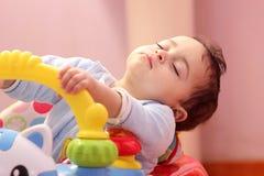 Sleeping baby girl. Arabian egyptian baby girl sleeping in her car Royalty Free Stock Photography