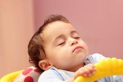 Sleeping baby girl. Arabian egyptian baby girl sleeping in her car Royalty Free Stock Photos