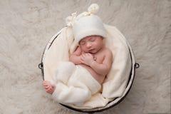 Sleeping Baby Girl in Bucket Royalty Free Stock Photo