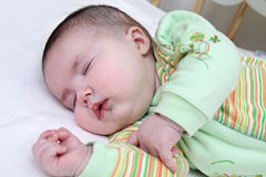 Sleeping baby girl. Close up of infant sleeping face Royalty Free Stock Images