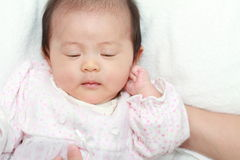 Sleeping baby girl. (Japanese 0 year old Stock Images