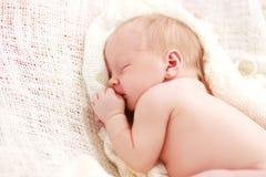 Sleeping baby girl. Newborn sleeping baby girl on a white blanket Royalty Free Stock Photography