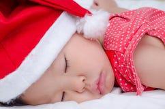 Sleeping baby girl Santa Claus Royalty Free Stock Image