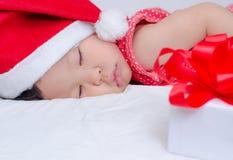 Sleeping baby girl Santa Claus Royalty Free Stock Photos