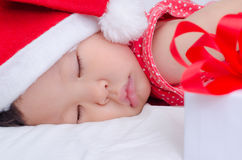 Sleeping baby girl Santa Claus Royalty Free Stock Photography