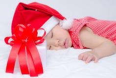 Sleeping baby girl Santa Claus Stock Photos
