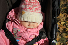 Sleeping baby girl. In warm pink clothes Stock Photography