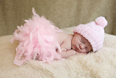 Sleeping Baby Girl Wearing Pink Hat royalty free stock photo