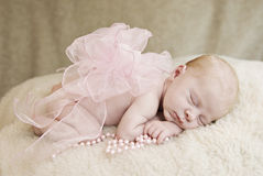Sleeping Baby Girl With Bow Stock Image