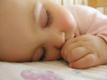 Sleeping baby with hand. And suckle finger stock photo
