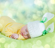 Sleeping baby in hare or rabbit hat Royalty Free Stock Images