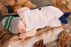Sleeping baby and hay. Stock Photography