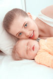 Sleeping baby and his mother Stock Photo
