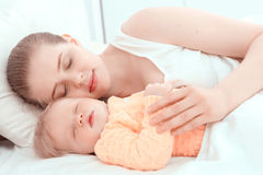Sleeping baby and his mother Royalty Free Stock Photo