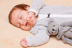 Sleeping baby. Little baby boy calmly sleeping with his teddybear Stock Photo