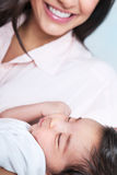 Sleeping baby on mothers hands Stock Image