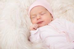 Sleeping Baby, New Born Kid Sleep in Fur, Beautiful Newborn Infant close up Portrait stock photo