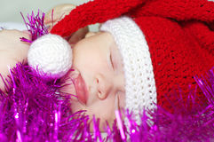 Sleeping baby in New Year's hat waiting gifts Royalty Free Stock Photo