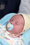 Sleeping baby with pacifier Stock Photo