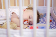 Sleeping baby with pacifier. Sleeping baby age of 1 year with pacifier Stock Photos