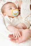 Sleeping baby portrait in mother hand, happy maternity and childhood concept, focus on face Royalty Free Stock Photos