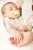 Sleeping baby portrait in mother hand, happy maternity and childhood concept, focus on face Royalty Free Stock Images