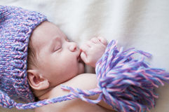 Sleeping baby in purple hat top view portrait Royalty Free Stock Images