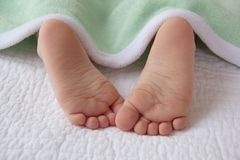 Sleeping baby's little feet Royalty Free Stock Photos