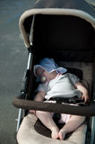 Sleeping baby in stroller Royalty Free Stock Photos