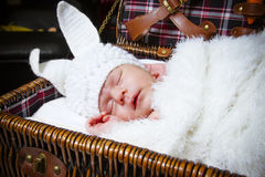 Sleeping baby in a suit of a rabbit Stock Images