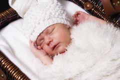 Sleeping baby in a suit of a rabbit Stock Photo
