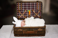 Sleeping baby in a suit of a rabbit Stock Photos
