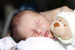 Sleeping baby with teddy Stock Photos