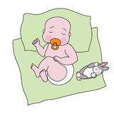 A sleeping baby with a toy rabbit Royalty Free Stock Photos