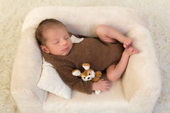 Sleeping baby with toy rabbit Royalty Free Stock Images