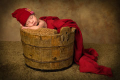 Sleeping baby in vintage bucket Stock Image