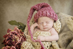 Sleeping Baby Wearing Hat stock photos