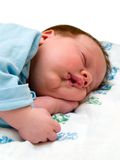 Sleeping baby on white. Angel baby Sleeping in home nursery isolated on white Royalty Free Stock Image